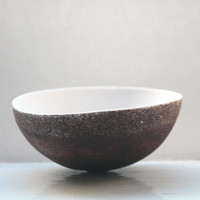 Stoneware white fine bone china decorative bowl with chocolate black exterior.