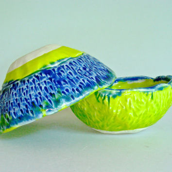 small bowl set in lime green and royal blue, spiral design