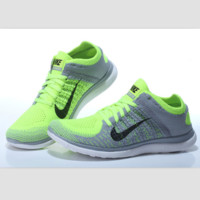 NIKE knitting flying line casual sports shoes Gray fluorescent green