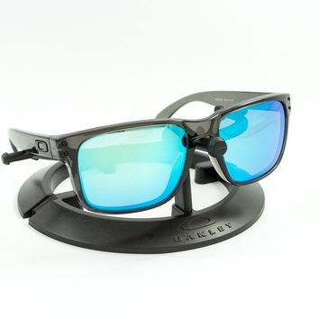 OAKLEY HOLBROOK GREY SMOKE FRAME / REVANT ICE BLUE POLARIZED CUSTOM LENSES