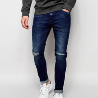 Produkt | Produkt Mid Wash Jeans with Rips in Super Skinny Fit at ASOS