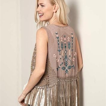 This bohemian style vest with solid cotton southwestern embroidery detailing at back panel, semi-sheer soft knit/woven crochet vest features an open front design, sleeveless, and completed with fringe bottom hem. Pair with skinny jeans, white tank top and