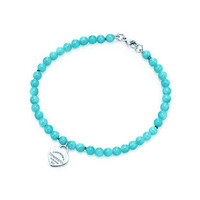 Tiffany & Co. - Return to Tiffany™ mini heart tag in silver on an amazonite bead bracelet.