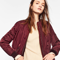 BOMBER JACKET WITH POCKETS DETAILS