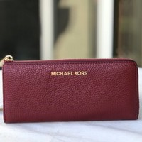 NWT MICHAEL KORS Leather Bedford Large Three Quarter Zip Wallet in Cherry