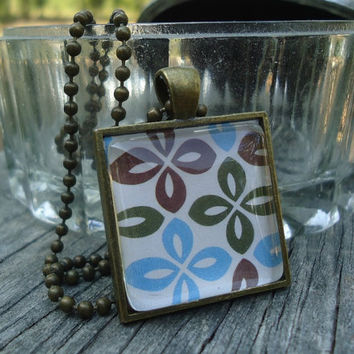 Green, Blue, Brown Flowers: A pendant charm necklace made from a glass tile and a square pendant tray