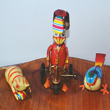 Three Tin Wind Up Toys, Duck On Tricycle, Cat With Ball, Tin Bird