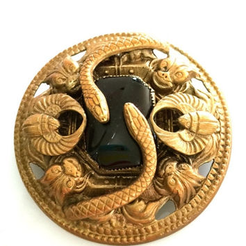 Art Deco Egyptian Revival Brooch, Large Black Glass Cabochon, Snakes, Winged Scarabs, and Gargoyles,1920s