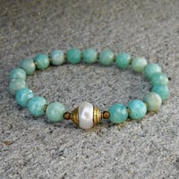 Amazonite gemstones, African trade beads, and Tibetan capped pearl guru bead mala bracelet
