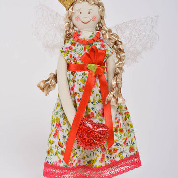 Handmade designer fabric soft doll princess in bright dress with floral pattern