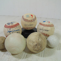 Vintage Well Used Sports Balls Collection of 8 Pieces - Genuine Regulation Game Played Baseballs, Lacrosse Balls, Golf Balls & Hockey Puck