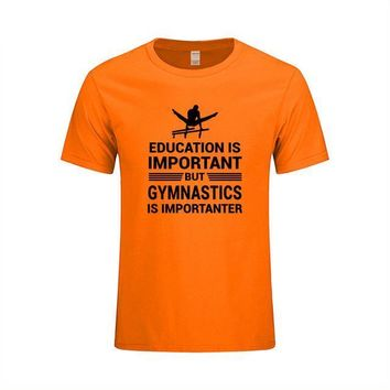 "Men's Gymnastics T-Shirt ""Education Important But Gymnastics is Importanter"" Orange"