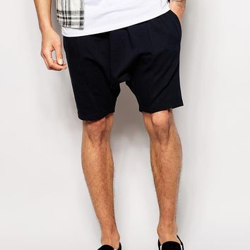 ASOS Jersey Shorts In Drop Crotch Mid Length at asos.com