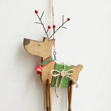 Reindeer ornament, wooden, Christmas tree ornament of reindeer in profile, brown green reindeer with bell and saddle, rustic, Xmas decor
