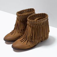 Suede fringed booties