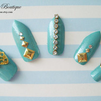 3D Bling Fake Nail Set  - Turquoise Glitter Nails with Bows, Gold Studs, and Clear Rhinestones