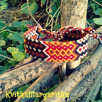 Woven wide friendship bracelet. red. white. mustard. black. brown.