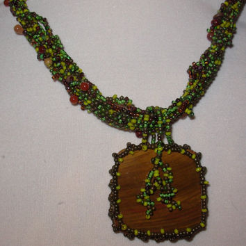 Hand Beaded Jewelry a Petrified Wood With Earth Tone Circular Peyote and Vine Ropes Necklace