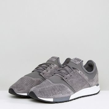 New Balance 247 Suede Trainers In Grey MRL247LY at asos.com