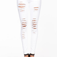 SLASHED WHITE SKINNY JEANS