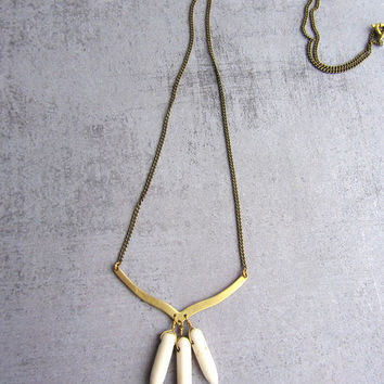Gold brass chevron arrow necklace with white stone spikes, stamement jewelry.