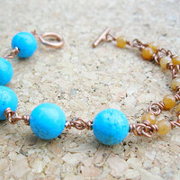 Copper bracelet, asymmetrical, with blue howlite and red aventurine gemstones