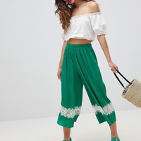 ASOS DESIGN Pleated Plisse Culotte Pants With Lace Insert at asos.com
