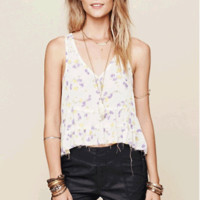 Fall in love with bohemian bonfire springtime with the Go Lightly Gauze Crinkle Breeze Trapeze Cami by Free People. Featuring a soft rayon fabrication, sleeveless, deep v-neckline, floral print throughout, three tier ruffle with raw hemline, wide open side