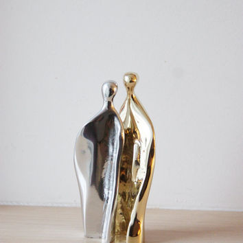 Man- woman abstract sculpture,  brass and aluminum set of two sculptures nesting into each other, Greek metal sculptures