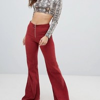 Sacred Hawk high waisted flared pants in cord at asos.com