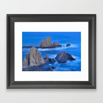 Blue sunset at the singing Mermaid Reef Framed Art Print by Guido Montañés