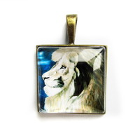 Pendant charm with glass dome and chain. lion.