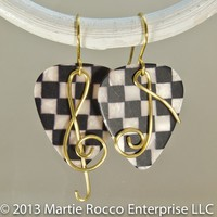 Black and white checker guitar pick earrings with gold music symbols.
