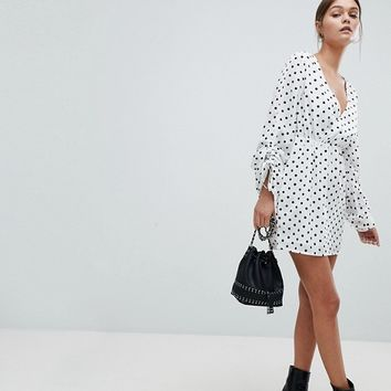 PrettyLittleThing Ruched Polka Dot Dress at asos.com