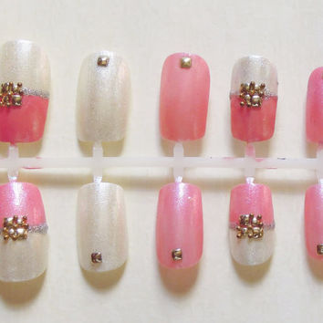 Light Pink and Shimmery White Japanese Inspired Fake Nails with Silver Glitter, and Gold Beads and Studs