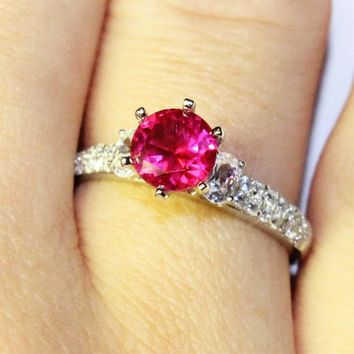 Ruby Promise Ring Solitaire Red Cubic Zirconia on Hand 1
