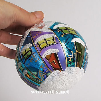 Hand-painted  blue Christmas blown- glass ball in a gift box. For Christmas and New Year's tree decoration. Christmas ornament. Blue houses.
