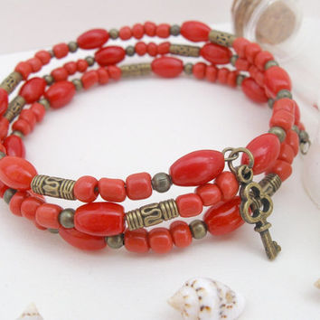 Coral red bracelet, bronze beads and key charm