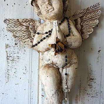 French Santos cherub statue w/ rusty crown distressed carved wooden angel wall hanging embellished religious home decor anita spero design