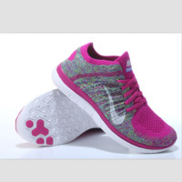 NIKE knitting flying line casual sports shoes Rose red