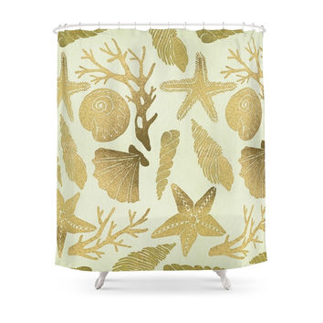 Society6 Gold Seashells Shower Curtains
