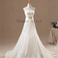 ivory a- line empire waist bridal wedding dress     strapless lace-up back wedding gowns with court train     organza lace bridal dresses