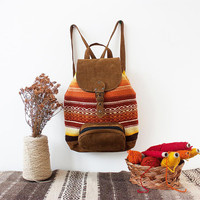 Handmade boho backpack in brown leather and colorful hand woven textile