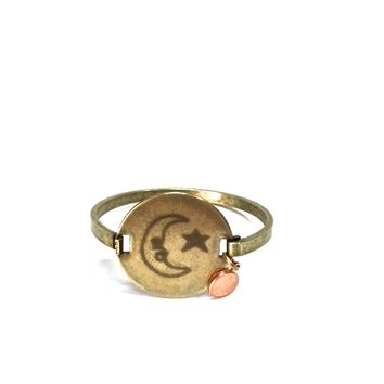 We would love to tell you a little bit about Top Shelf brand jewelry line so you may appreciate the wonderful handcrafted Engraved Moon & Star vintage brass locker tag cuff with a dainty copper color penny you are looking at! This is a costume jewelry manu