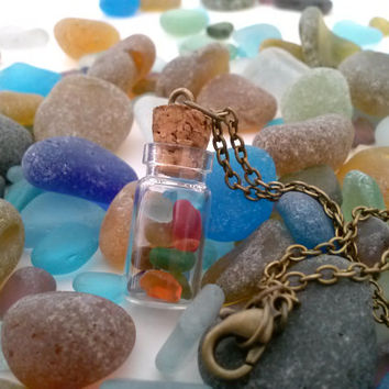 recycled go green sea glass in a tiny glass charm bottle with a 18 inch hand made bronze like chain , cork top