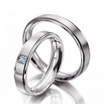 14k white gold his and her custom wedding bands.