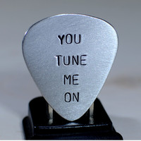 Aluminum guitar pick with You Tune Me On