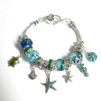 Silver & Blue Glass Bead Sea Life Nautical Charm Bracelet - Starfish, Seahorse, Clam, Turtle Blue Glass Silver Beaded Charm Bracelet