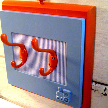 Child's coat rack with a Train Theme, accessory holder, complementary colors of orange and blue for a boys room decor
