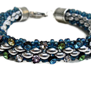 Silver and blue beaded bracelet, decorated with multicolor Swarovski elements.